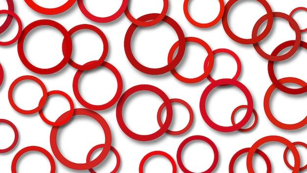 Abstrakcyjna ilustracja losowo ułożonych czerwonych pierścieni z miękkimi cieniami na białym tle