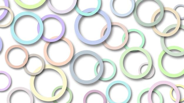 Abstrakcyjna ilustracja losowo ułożonych kolorowych pierścieni z miękkimi cieniami na białym tle