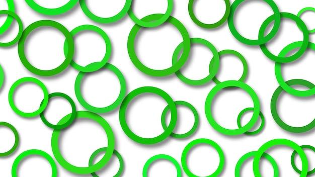 Abstrakcyjna ilustracja losowo ułożonych zielonych pierścieni z miękkimi cieniami na białym tle