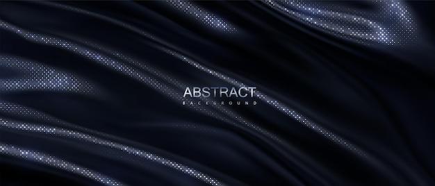 Abstrakcyjne tło czarnej falistej tkaniny ze srebrnym wzorem błyszczy