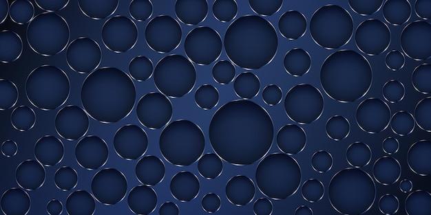 Abstrakcyjne tło wykonane z dużych dziur w różnych rozmiarach z błyszczącymi krawędziami w ciemnoniebieskich kolorach