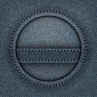 Abstrakcyjny niebieski denim z okrągłą ramką ze szwami i paskiem w środku koła.