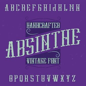 Absynt alfabetyczny i przykładowy projekt etykiety z dekoracją. ręcznie wykonana czcionka, dobra do użycia na etykietach w stylu vintage.