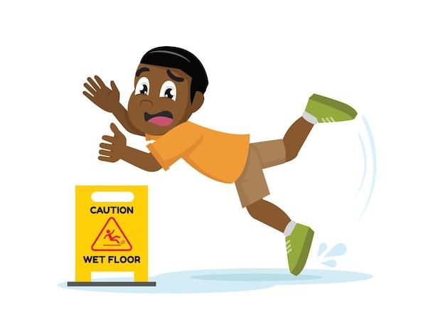 African boy poślizgnął się na mokrej nawierzchni