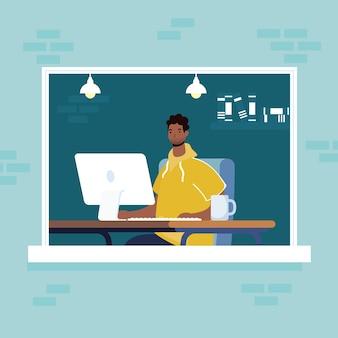 Afro człowiek za pomocą komputera stacjonarnego w scenie okna w miejscu pracy