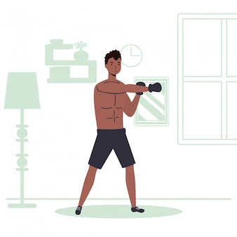 Afro mężczyzna ćwiczy boks aktywność sportową w domu