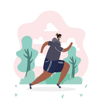 Afro mężczyzna jest ubranym medyczną maskową bieg sport w parku