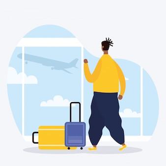 Afro młody człowiek z walizką