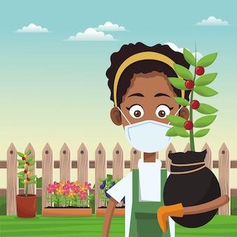 Afro żeński rolnik jest ubranym medyczną maskową scenę
