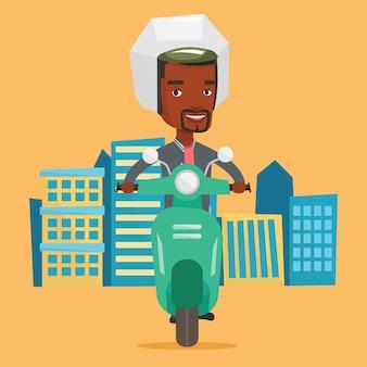 Afroamerykański mężczyzna jedzie hulajnoga w mieście.