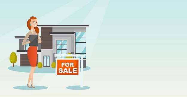 Agent nieruchomości podpisujący umowę zakupu domu.