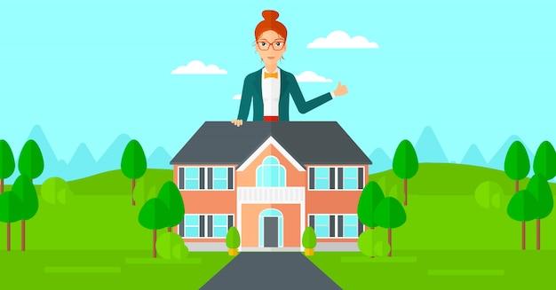 Agent nieruchomości pokazuje kciuk up.
