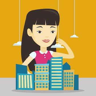 Agent nieruchomości przedstawiający model miasta.