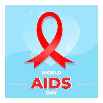 Aids dzień czerwoną wstążką na niebieskim sercu
