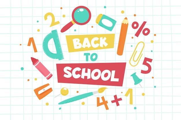 Akcesoria szkolne z powrotem do tła szkoły