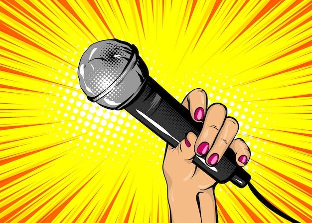 Aktualności piosenkarka komiks tekst dymek kobieta pop-art styl moda dziewczyna ręka trzyma mikrofon kreskówka