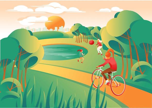 Aktywni ludzie w parku grając i jeżdżąc na rowerze.