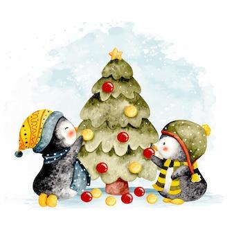 Akwarela dwa małe inguin dekorujące choinkę