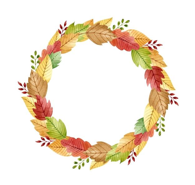 Akwarela jesienny wianek ze stylizowanymi złotymi, zielonymi, czerwonymi, brązowymi liśćmi i gałązkami
