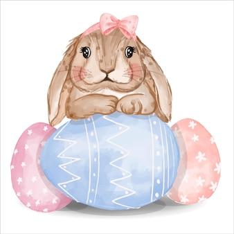 Akwarela króliczek z różowymi i niebieskimi jajkami
