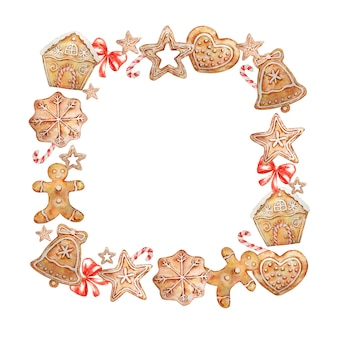 Akwarela kwadratowy wieniec bożonarodzeniowy z piernikami, cukierkami i czerwoną kokardką.