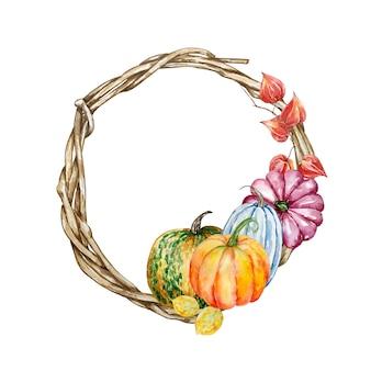 Akwarela ręcznie malowany wieniec z gałęzi jesień. drewniany wieniec z kolorowymi dyniami, jesiennymi liśćmi i pęcherzycą. ilustracja jesień do projektowania i tła