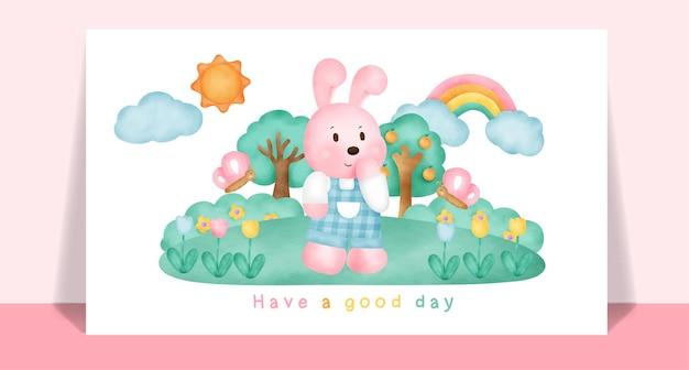 Akwarela słodkie króliki w ogrodzie na pocztówkę.