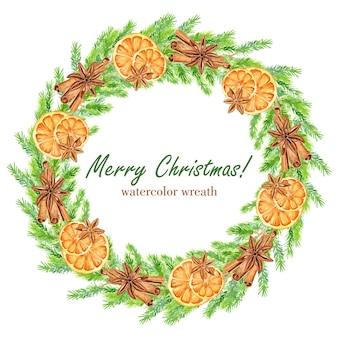 Akwarela wieniec bożonarodzeniowy z gałązkami jodły, pomarańczami, gwiazdkami anyżu i laskami cynamonu. rama kwiatowy
