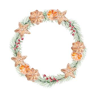 Akwarela wieniec bożonarodzeniowy z gałązkami sosny i jagodami, z piernikami i plastrem pomarańczy.