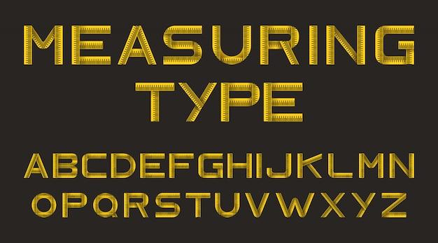 Alfabet z żółtej taśmy mierniczej