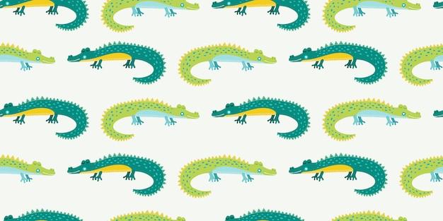 Aligator kreskówka dla dzieci. wzór z zielonymi krokodylami rysowane nahd.