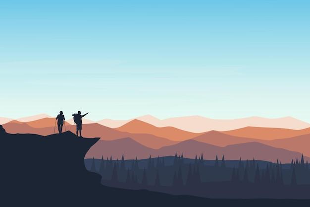 Alpiniści o płaskim krajobrazie, którzy widzą piękną atmosferę
