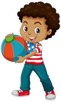 Amerykański chłopiec trzyma piłkę koloru
