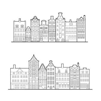 Amsterdam stare domy w stylu. typowe holenderskie domy nad kanałem ustawione w szeregu w pobliżu kanału w holandii.