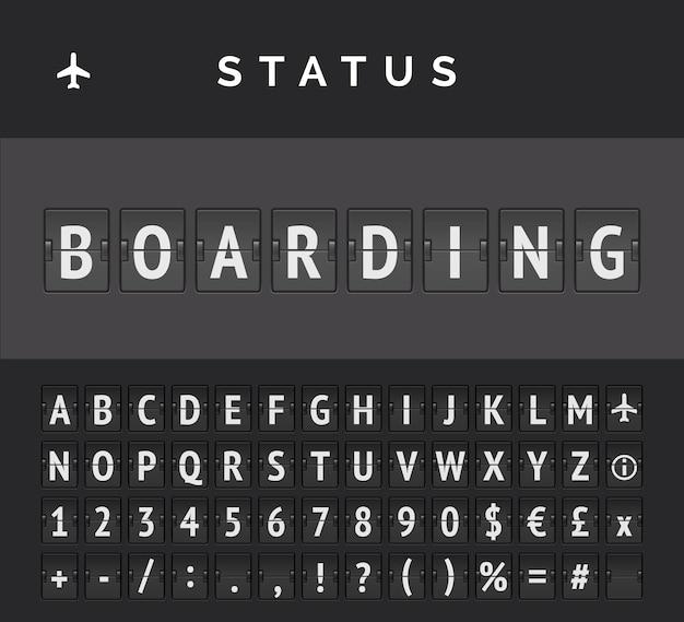 Analogowy rozkład jazdy z tablicą pokazującą informacje o locie na lotnisku o statusie odlotu: wejście na pokład, z ikoną znaku samolotu i abc
