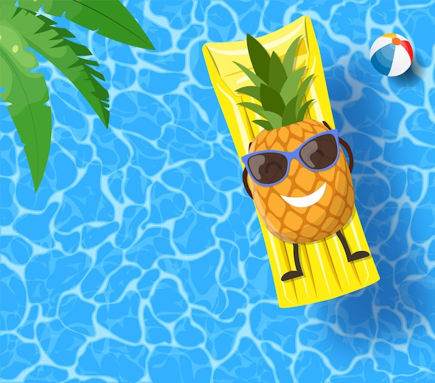 Ananas leżący na materacu nad wodą