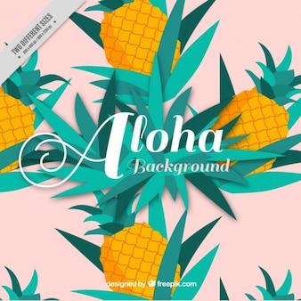 Ananasy i liści w tle