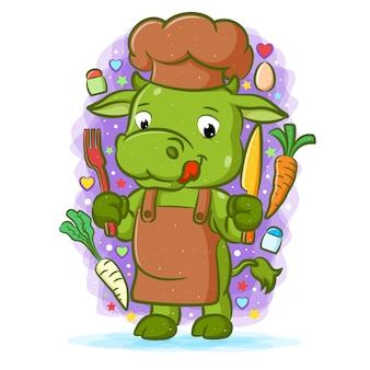Animacja zielonej krowy mistrza kuchni trzymającej narzędzia do jedzenia z warzywami
