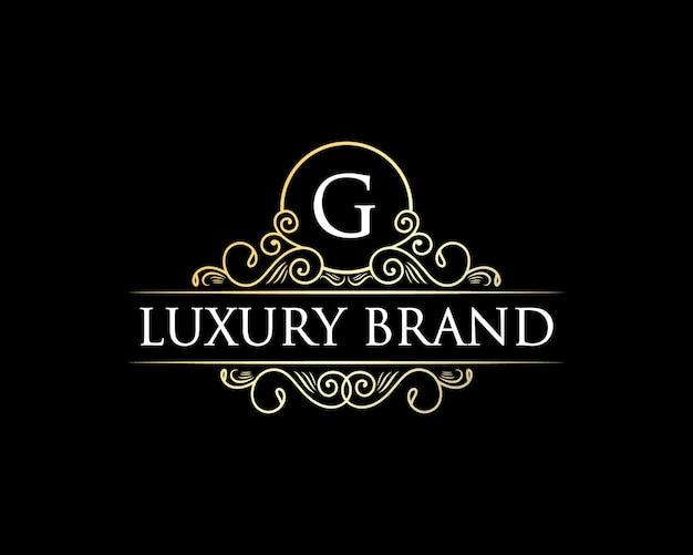 Antyczne retro luksusowe logo wiktoriańskiego godła z kwiecistą ozdobną ramą