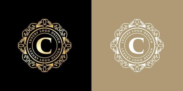 Antyczne retro luksusowe wiktoriańskie godło kaligraficzne logo z ozdobną ramką