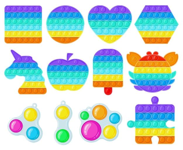 Antystres pop it i proste zabawki z wgłębieniami. modne zabawki dla dzieci fidget, nauka sensoryczna i kolorowa dla dzieci zestaw ilustracji wektorowych. zabawki z bąbelkami silikonowymi
