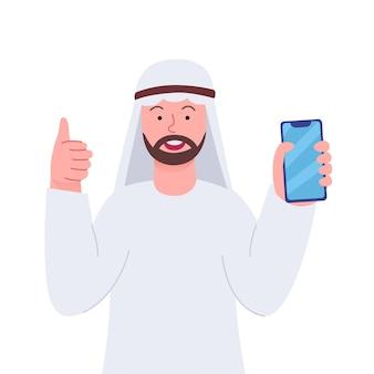 Arabian man smile kciuki do góry trzymając smartfon