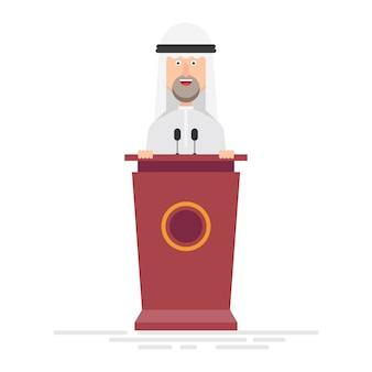 Arabski biznesmen przemawia na podium