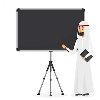 Arabski biznesmen robi prezentaci na flipchart
