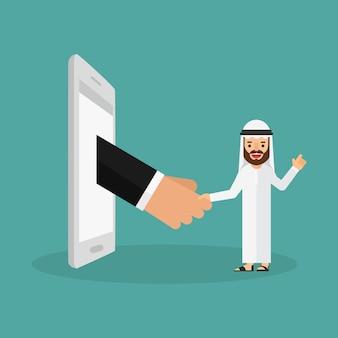 Arabski biznesmen trzęsie rękami z kimś z telefonu