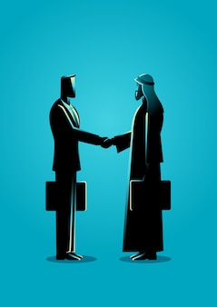 Arabski biznesmen uścisnąć dłoń z zachodnim biznesmenem