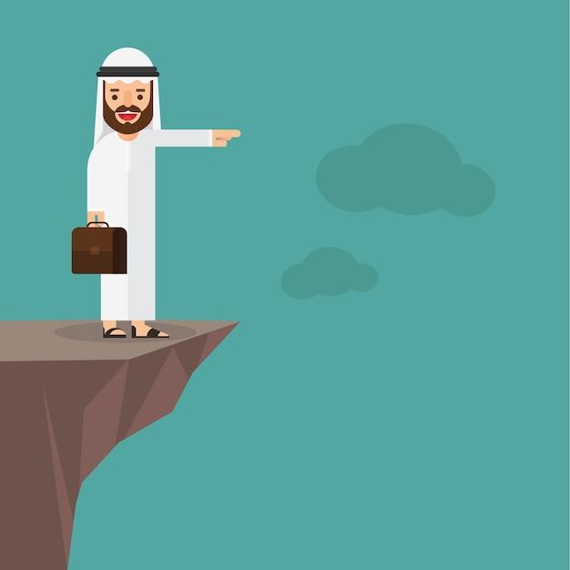 Arabski biznesmena stojak na górze góry