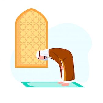 Arabski człowiek ćwiczący kłaniając się w modlitwie