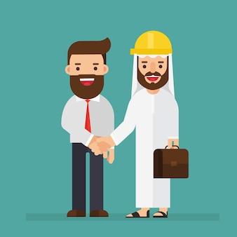 Arabski inżynier i biznesmen talking and shakes hand
