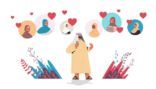Arabski mężczyzna rozmawiający z arabskimi kobietami w aplikacji randkowej online wirtualne spotkanie komunikacja społeczna znaleźć koncepcję miłości izolowaną poziomą pełną długość ilustrację